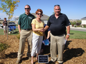 Cox Professional Landscape and Busy Bloomers dedicate landscaping at Heritage Eagle Bend
